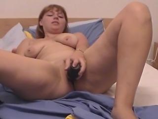 Redhead curly hot MILF is enjoying deep touchy masturbation.