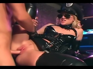 Sexy female cop in uniform and shiny latex gloves fucking on her car