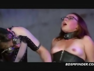 Redhead in a corset gets her shaved pussy dominated