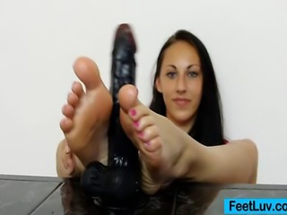 Teen hottie undresses her socks to show her bare feet then she strokes a...