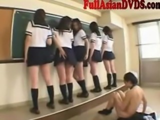 Asian School Girls Play in Classroom