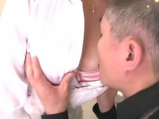 Big titty Araki has a blast in her bosses kitchen giving him a titty job