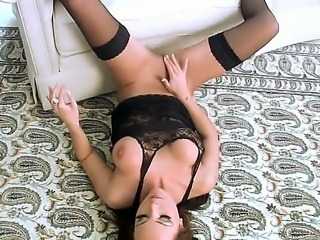 Adorable babe with sensual stockings Harley Kent enjoys a lovely softcore solo