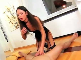 Young hot brunette Nataly Gold bent over in hot black lingerie and pleasuring...