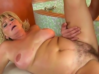 Wonderful grandma Sally G. is horny as always and today she is showing us...