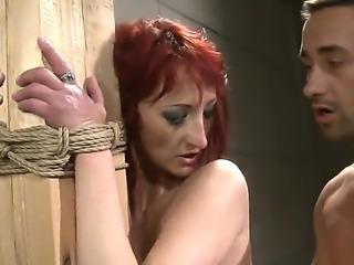 Look at amazing red-head vixen Krisztin getting fucked in bdsm hardcore scene