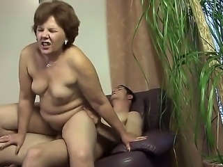 Mature babe with big tits Caitlin enjoys young meat drilling her shaved and...