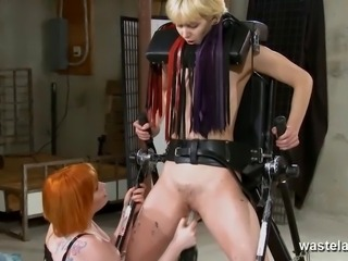 Ginger dominatrix plays with blondes pussy like a toy