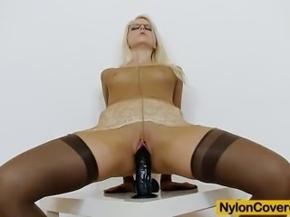 Handsome slim babe wears pantyhose on legs and all over her body and teases a...