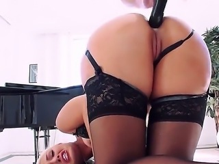 Jenna Ivory is a blonde girl wearing lingerie who loves to suck a dick while...