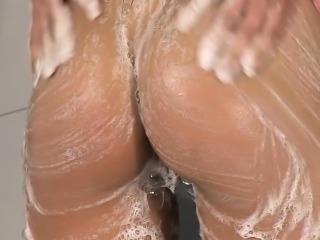 Stunning girl enjoys rubbing herself in the shower