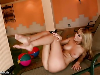 Blonde minx Antonya with big tits fucks herself like crazy in solo scene