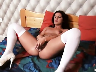 Solo girl plays with a dildo