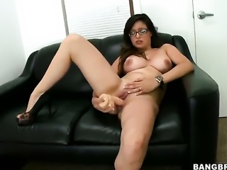 Brunette is using a large dildo