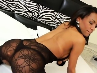 Busty ebony transsexual Cintia Matarazzo solo plays