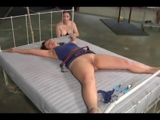 husband ties wife in bed