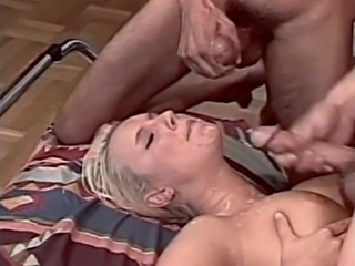 Blonde lays back for a simultaneous cum shower on her face
