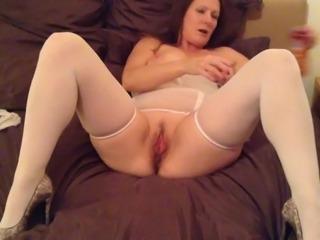 Mature lady in lingerie masturbate