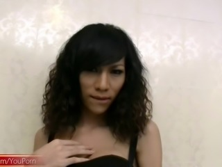 Curly haired ladyboy strips down and masturbates her shemeat