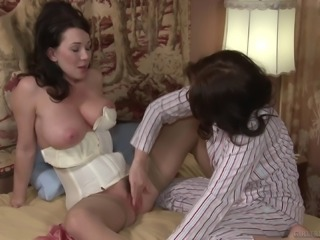 Satin robe and erotic lingerie on a lovemaking lesbian mom