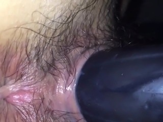 Hairy Japanese girl with a toy in her pussy