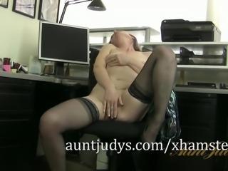 Redheaded MILF Amber Masturbates in her Office