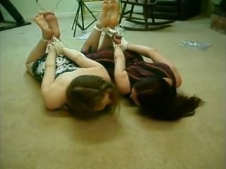 Two girls wake up hogtied