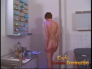 Dominatrix works hard to find out what her slave's pain thre