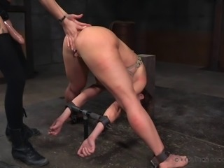 Luscious bombshell with huge tatas gets tied up and spanked hard