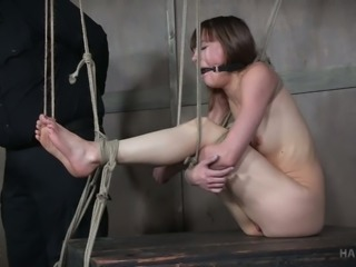 Cute white chick gagged and teased with sharp wooden stick