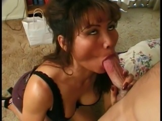 Hot Asian MILF gets on her knees and gives young dude a great sex