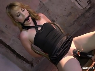 The blonde milf was tied up to a chair in the dungeon and the cruel master...