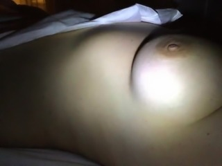 night creep checking out naked MILF in her bed