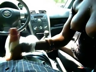 Black girl with big boobs gives handjob in car