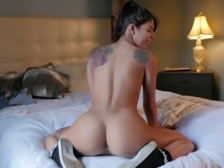 Sexy brunette Gina Valentina shows off her pinkish yummy pussy doggy style