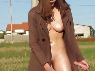 Cute brunette playing with pussy and dildo in public