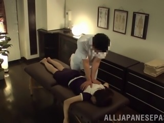 Big Japanese tits bounce during sex on a massage table