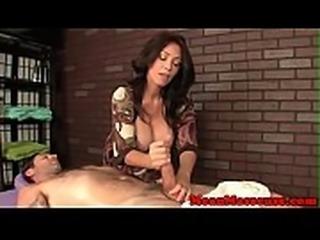 MILF masseuse dominates her cumming client