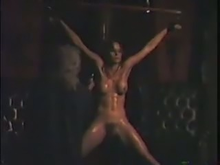 Tied up and crucified vintage slut gets treated in a hard way