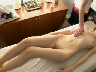 Skinny brunette massaged and fucked on the table
