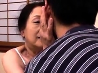 Insatiable Japanese granny buries a young dick in her cunt