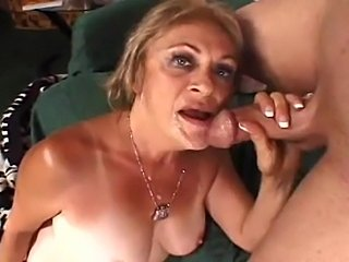 Kinky granny in stockings handles a large tool
