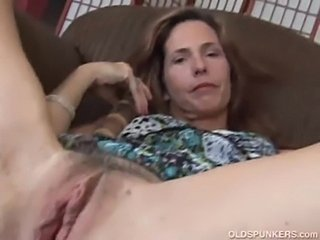 Mature redhead fucks her pussy and asshole  free