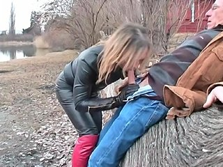 leather shemale doing bj outdoors