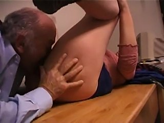Horny mom with glasses blows a cock and licks ass