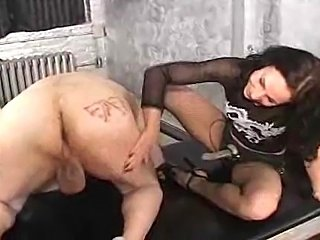 A pathetic slave is fucked in the ass by mistress Trish